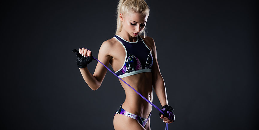 beautiful fitness woman with the jump rope