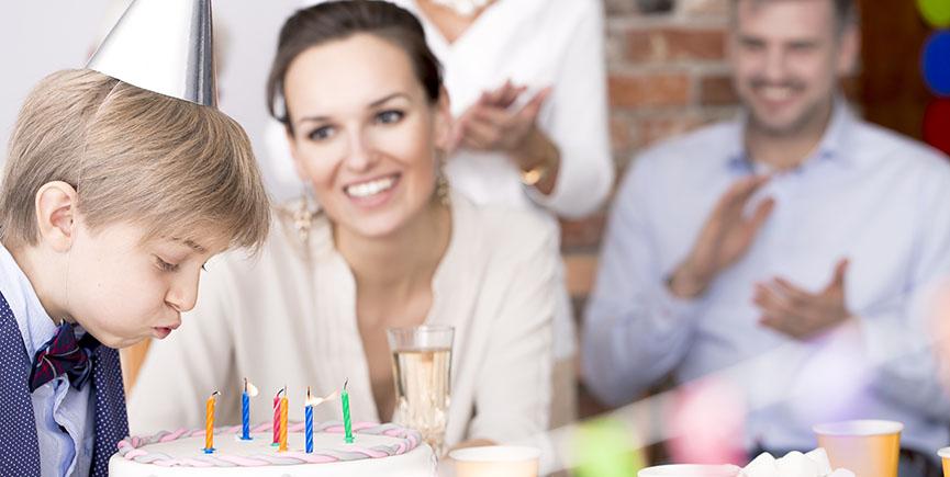 Birthday boy blowing candles