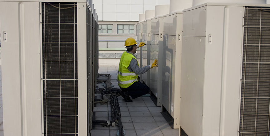 AC Tech Testing Voltage on the roof