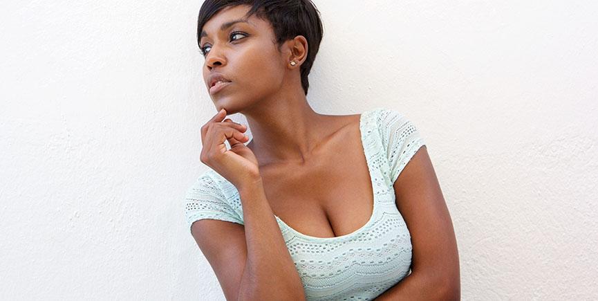 Elegant black woman posing against white background