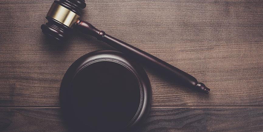 judge gavel on brown wooden background