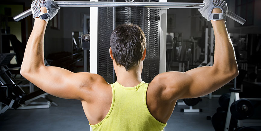 Man in Fitness Gym Doing Weight Lifting