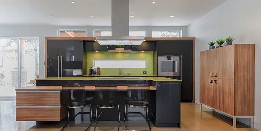 Modern kitchen with green quartz counter top