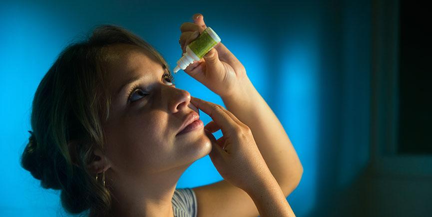 Woman With Eyes Tired Applying Collyrium Eye Drops
