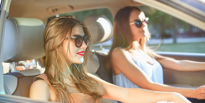 young women in the car smiling